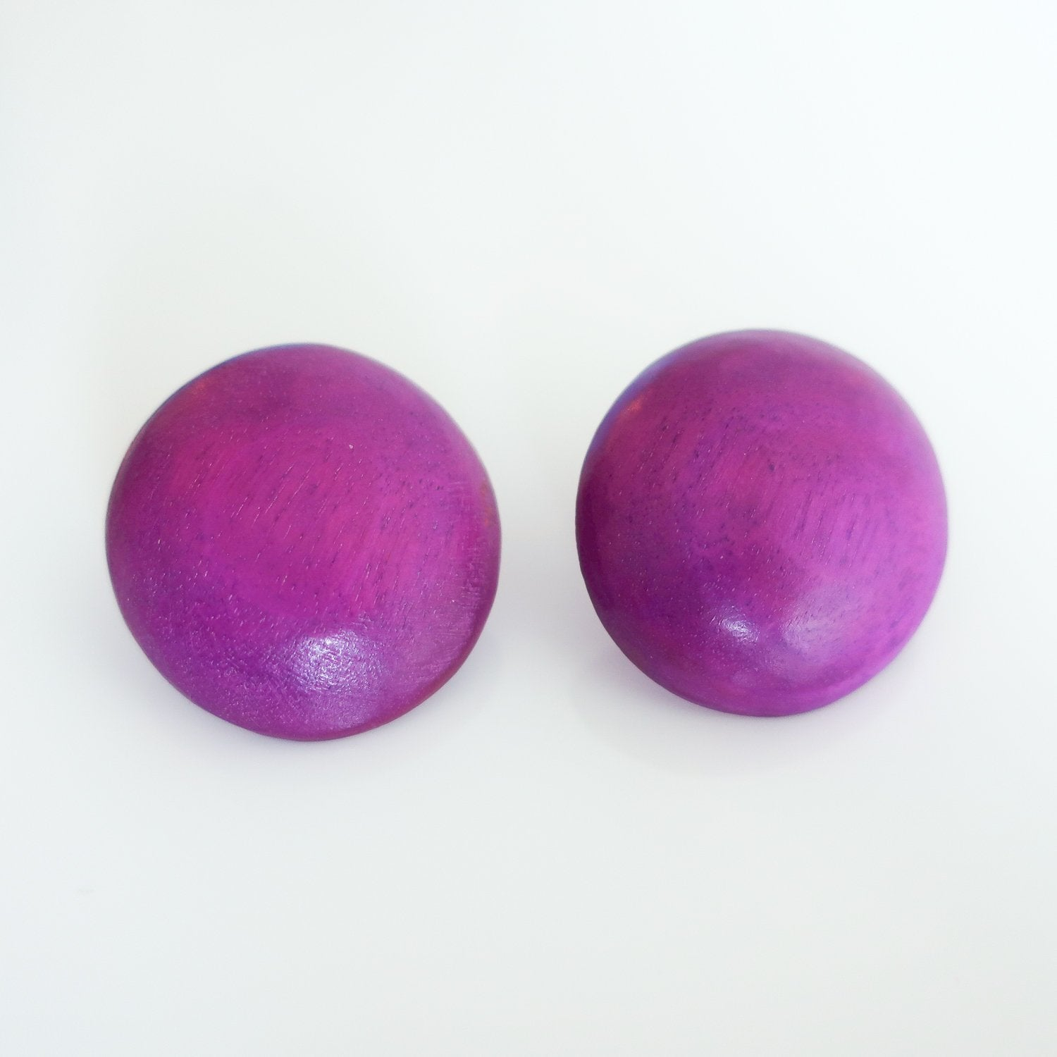 "Second Room Vintage Clothing. Vintage purple wood stud earrings, that look hand crafted and are not perfectly symmetrical. You can also slightly see the wood grain through the painted finish. Earrings are approximately 1.25"" across. Free North American shipping on all orders."