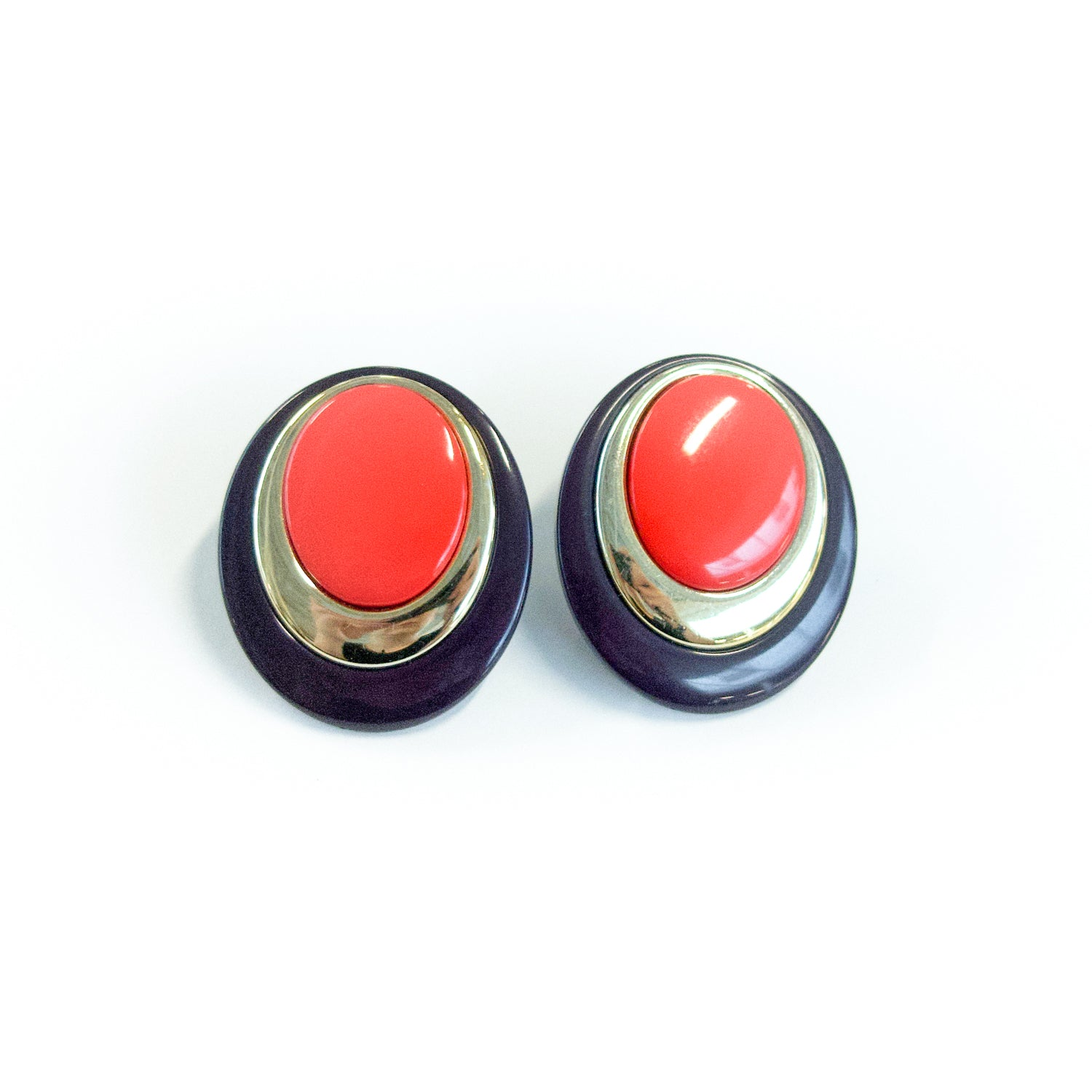 "Second Room Vintage Clothing. Vintage navy blue, red and gold tone oval stud earrings. Earrings are 1.25"" wide and 1.5"" tall. Original earring backs have been replaced with new, clear silicone backings. Free North American shipping on all orders."