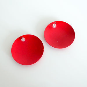 "Second Room Vintage Clothing. Vintage bright red painted metal (enamel) round stud earrings; 1.25"" wide. Original earring backs have been replaced with new, clear silicone backings. Free North American shipping on all orders."