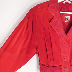 Second Room Vintage Clothing. Vintage 80s cropped red suede jacket with the most amazing embossed rose pattern panels. This jacket is fully lined in red, has 3 snaps for closure, pleated details at the shoulder and front waist, with dolman sleeves and shoulder pads. Free North American shipping on all orders.