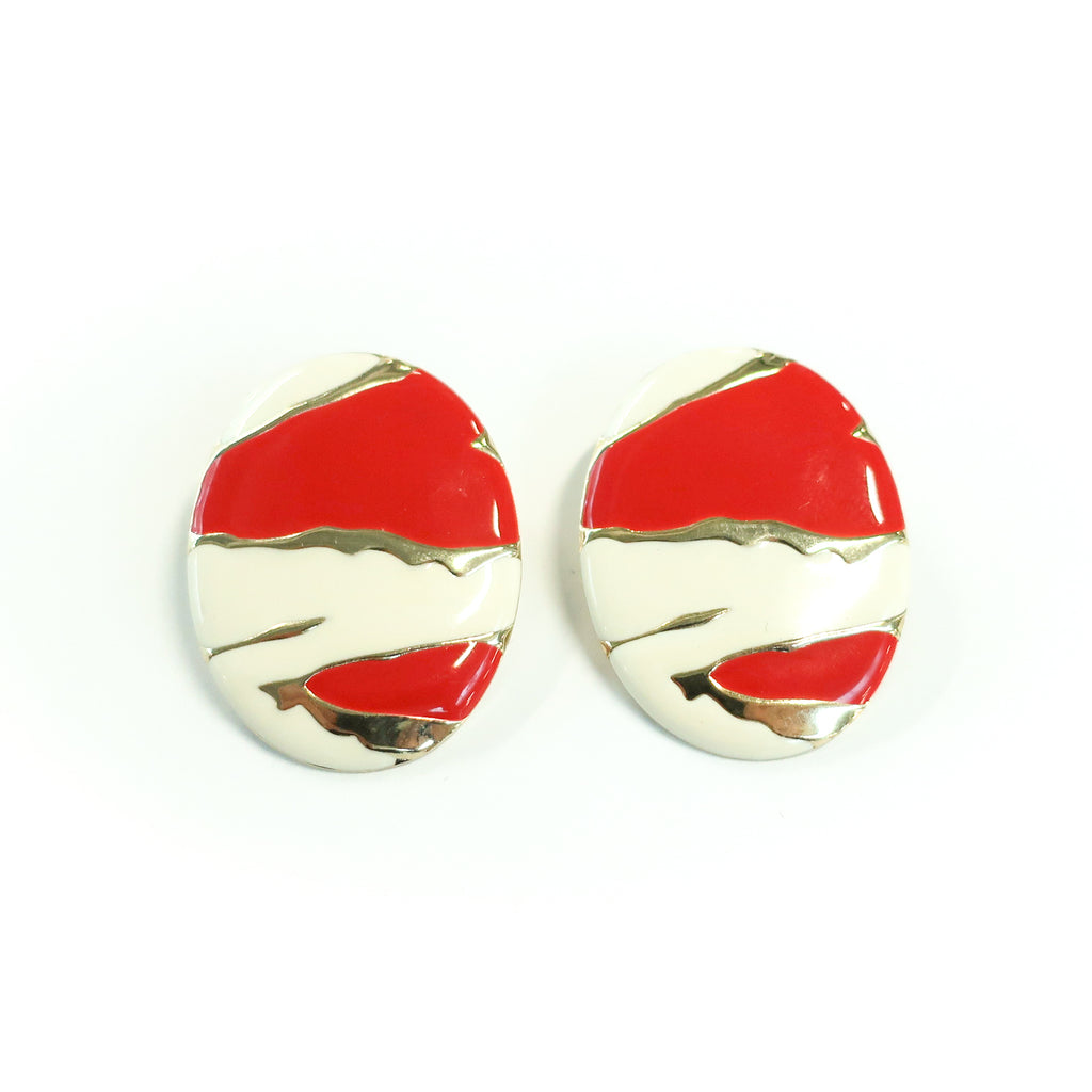 "Second Room Vintage Clothing. Vintage oval, white and red enamel painted earrings with abstract design and gold tone details. Earrings are 1.5"" wide and 1.75"" tall. Original earring backs have been replaced with new, clear silicone backings. Free North American shipping on all orders."