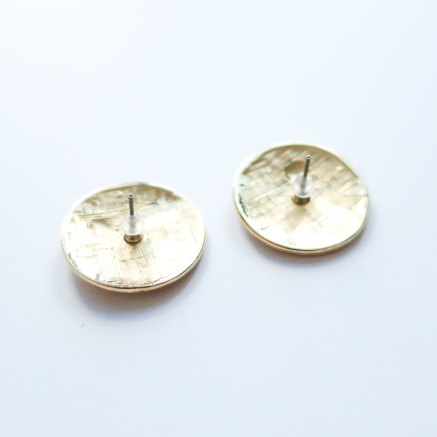 "Second Room Vintage Clothing. Vintage gold tone round studs with triangle, circle and arrow shapes in red and green. Earrings are 1"" round. Free North American shipping on all orders."