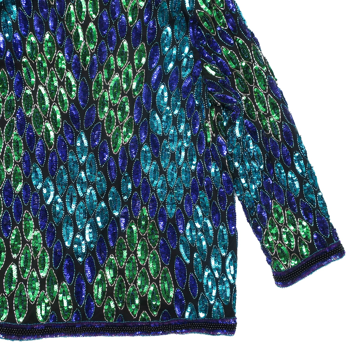 Second Room Vintage Clothing. Make a statement this season with this amazing blue, purple, green and black sequin jacket! This jacket is 100% black silk, with a rayon lining, and is in absolutely pristine condition, without one sequin or bead out of place. Free Shipping on all orders within North America.
