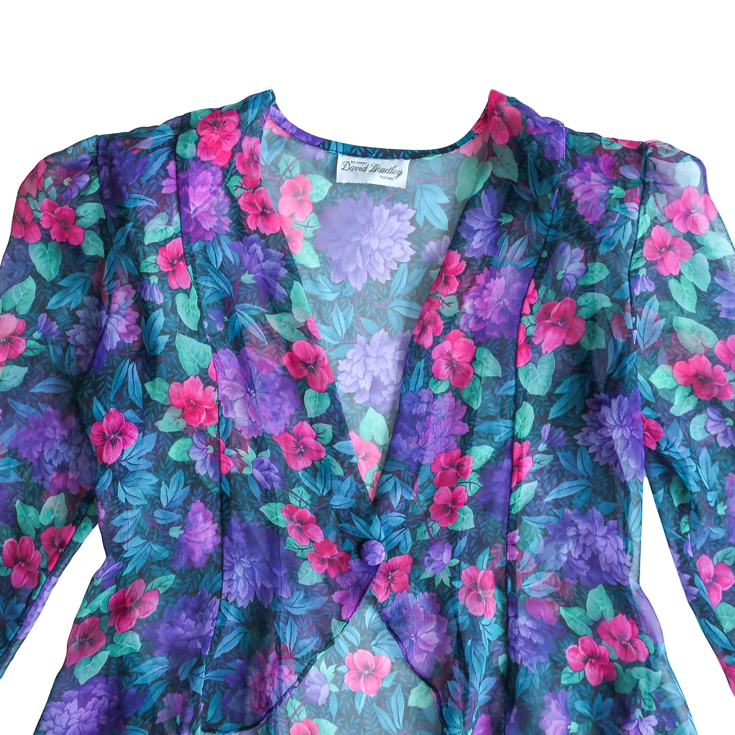 Second Room Shop Vintage. Shop Vintage, Shop Sustainable. Vintage sheer floral peplum top. This could be worn over another shirt as a sheer jacket, or by itself with just a bralette. It has one fabric covered button for closure, and shoulder pads that could be easily removed. It is cut shorter in the front, and longer in the back.