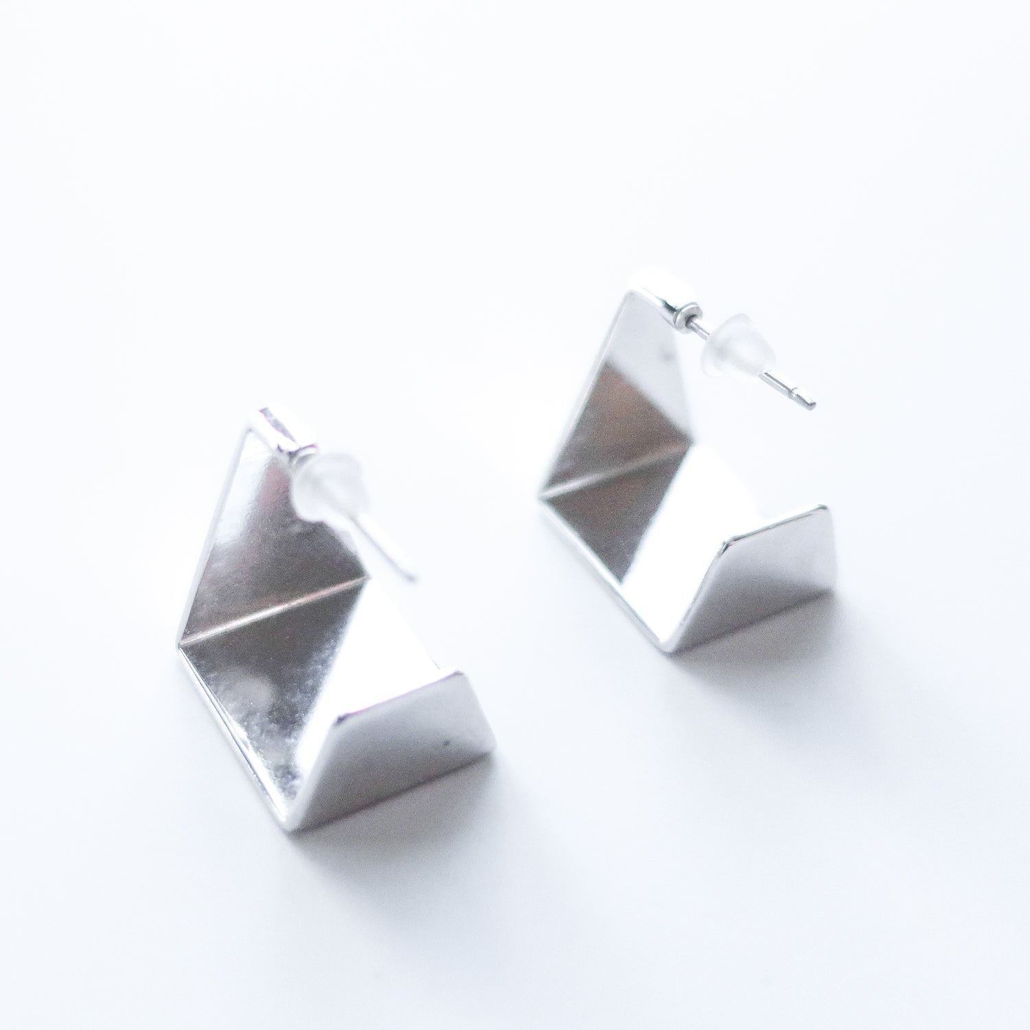 "Second Room Vintage Clothing. Vintage silver tone, triangle and square shaped open hoop earrings. These earrings are 1/2"" all around. Free North American shipping on all orders."