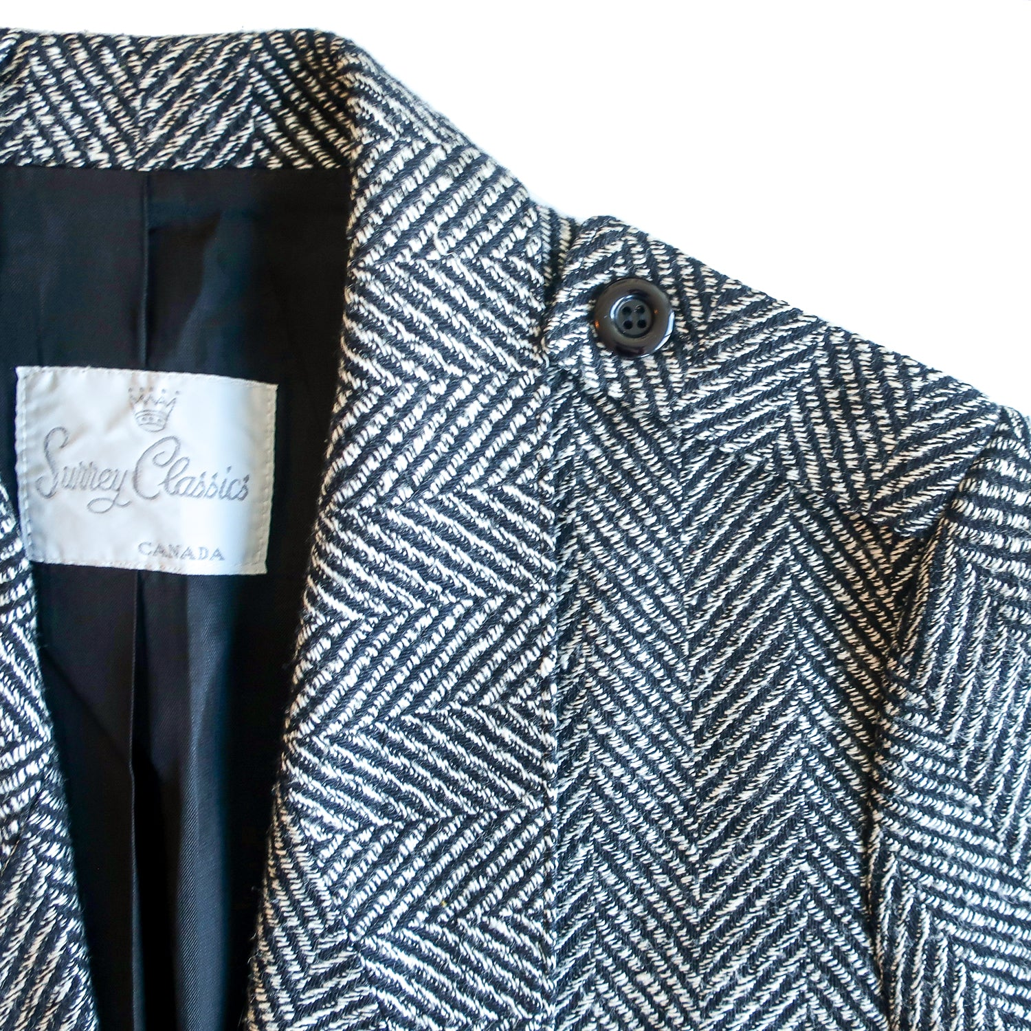 Second Room Vintage Clothing. Vintage black, grey and white chevron print open blazer, with 3/4 bracelet sleeve. Fully lined in black, with two front pockets, and epaulets on the shoulders with black buttons. No shoulder pads, Made in Canada. Free North American shipping on all orders.