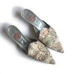 Second Room Shop Vintage. Shop vintage, shop sustainable. Beautiful vintage mules with tapestry pattern fabric upper, silver kitten heel, and leather sole. Perfectly pointed toe and Made in Italy.