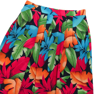 Second Room Vintage Clothing. Vintage pleated tropical leaf print midi skirt in black, bright orange, blue, green and red. Unlined, with elastic back and two side pockets! Free North American shipping on all orders.