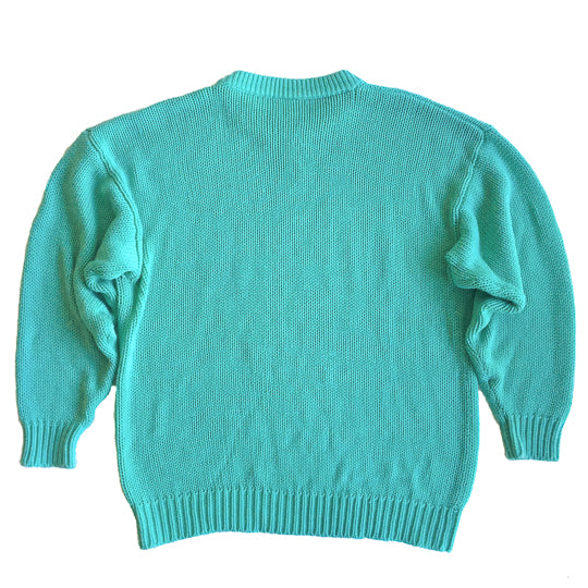 Second Room Shop Vintage. Shop vintage, shop sustainable. Vintage turquoise crewneck sweater, with square pattern in front, and a perfect oversize fit.