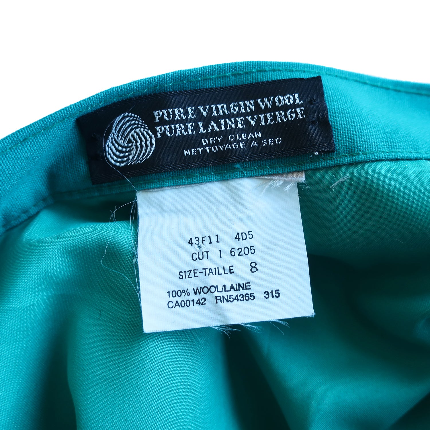Second Room Vintage Clothing. Vintage bright turquoise blue/green fully lined and pleated wool midi skirt, with side zipper and button closure; dry clean only. Free North American shipping on all orders.