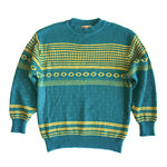 Second Room Shop Vintage. Shop vintage, shop sustainable. Vintage turquoise and yellow patterned sweater. Crewneck, with ribbed neck, cuffs, and bottom.