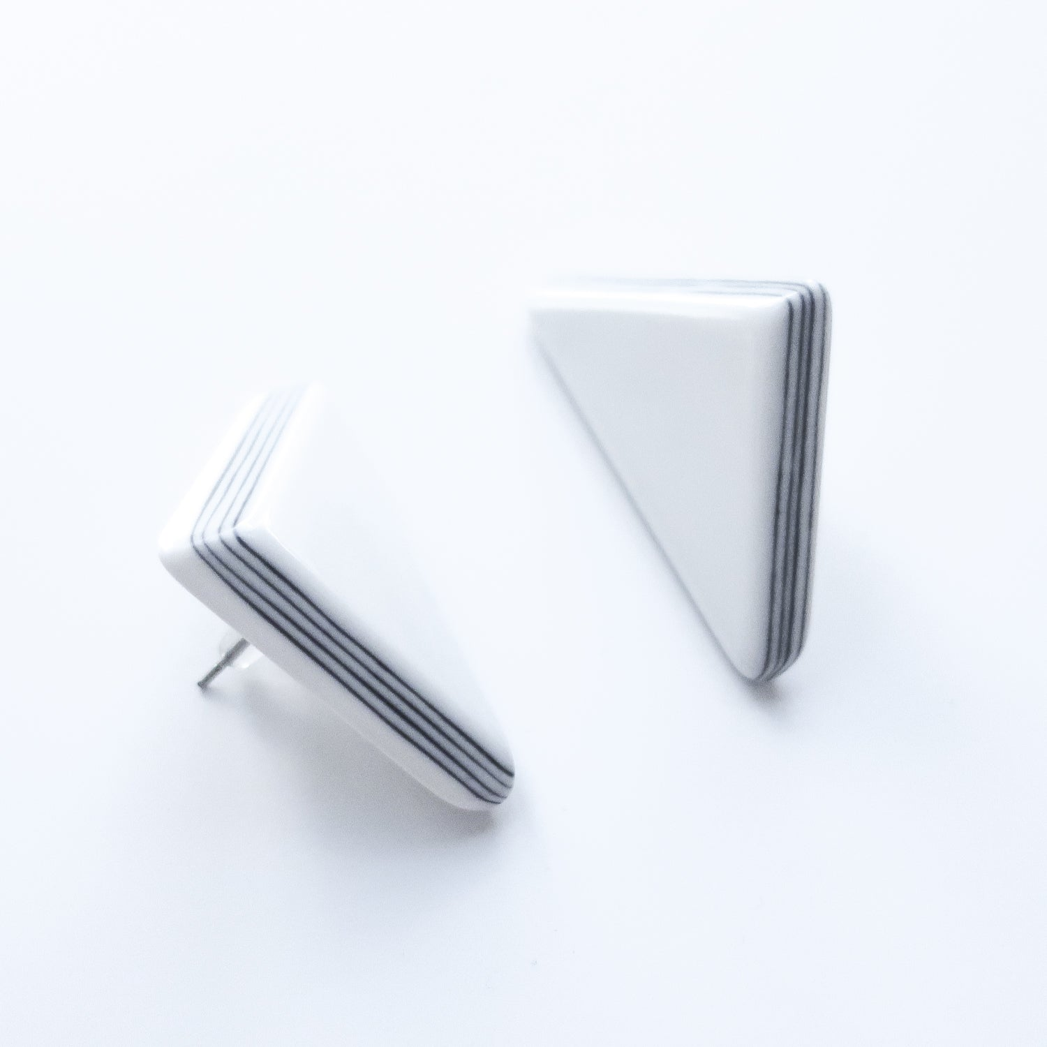 "Second Room Vintage Clothing. Vintage 80s white triangle stud earrings with tiny black stripes on the sides. These earrings are 1"" wide and 1-1/2"" tall. Original earring backs have been replaced with new, clear silicone backings. Free North American shipping on all orders."