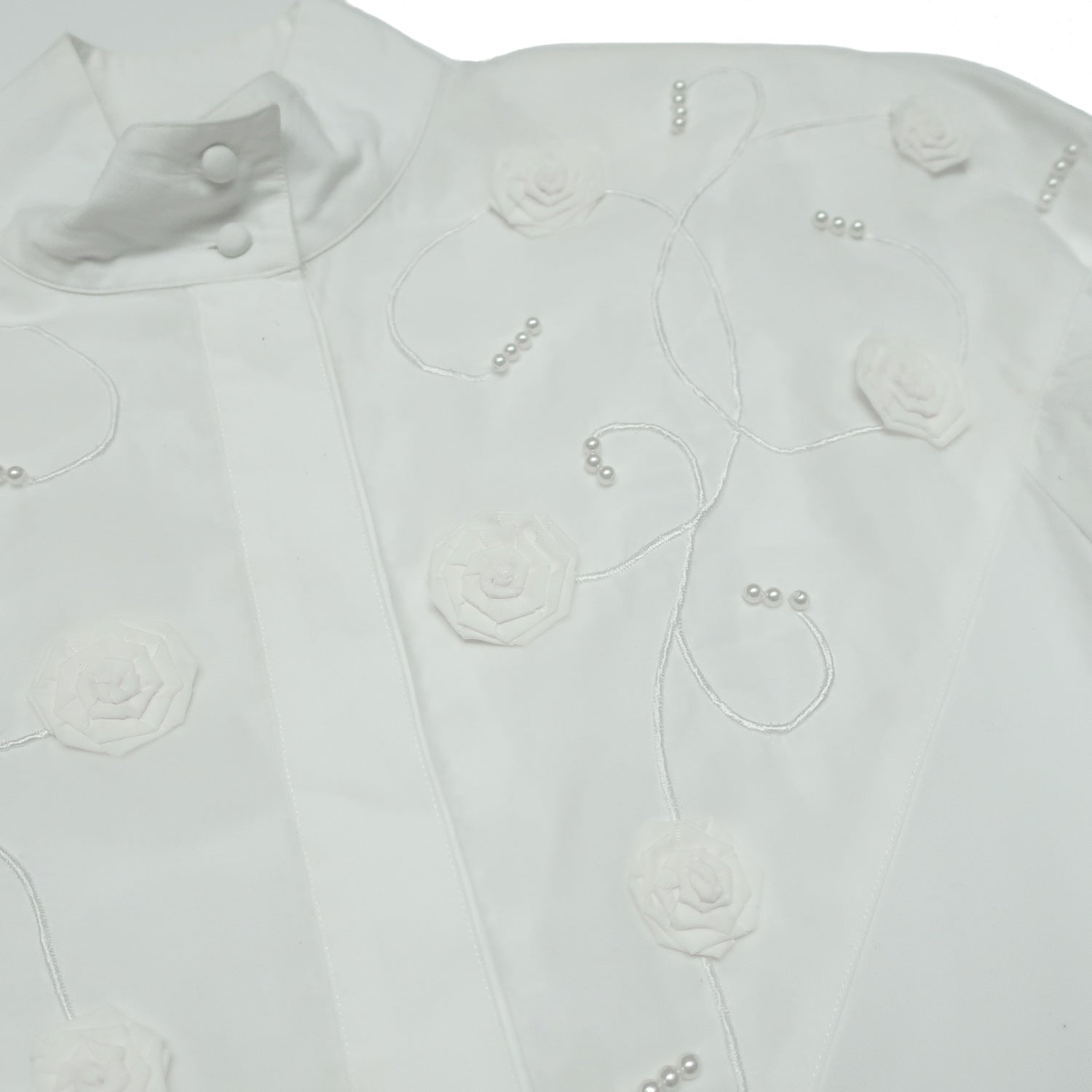 Second Room Vintage Clothing. Vintage long sleeve white cotton blouse, with three dimensional fabric flowers and faux pearl beading on the chest.  Free Shipping on all orders within North America.