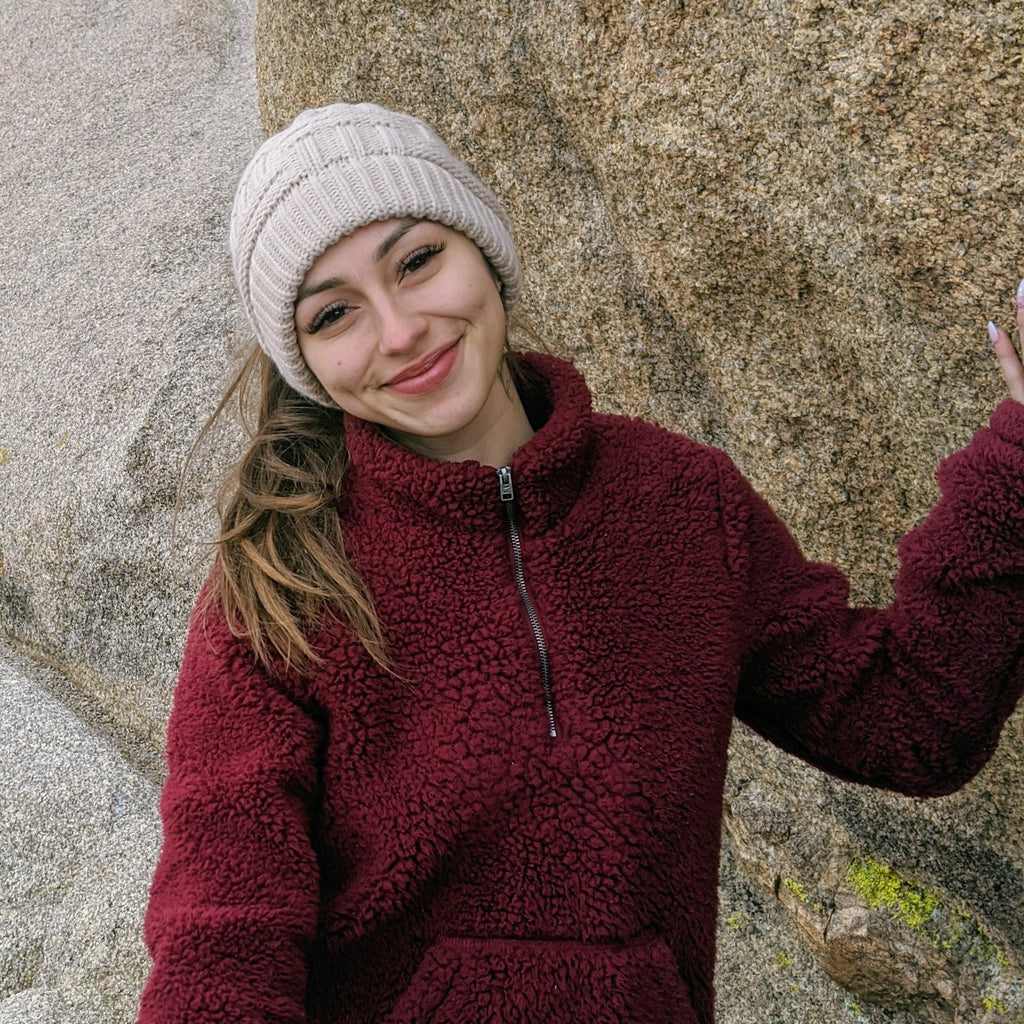 girl in nature wearing beanie