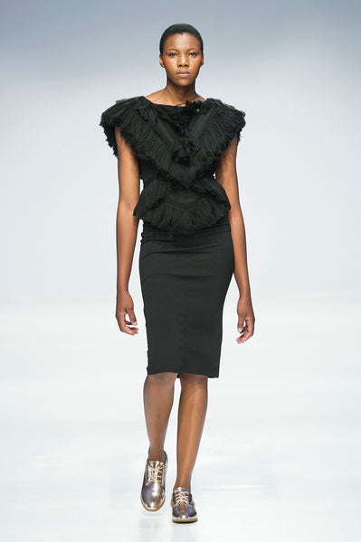 Black pencil dress with sculptural fringe detail over shoulders and top