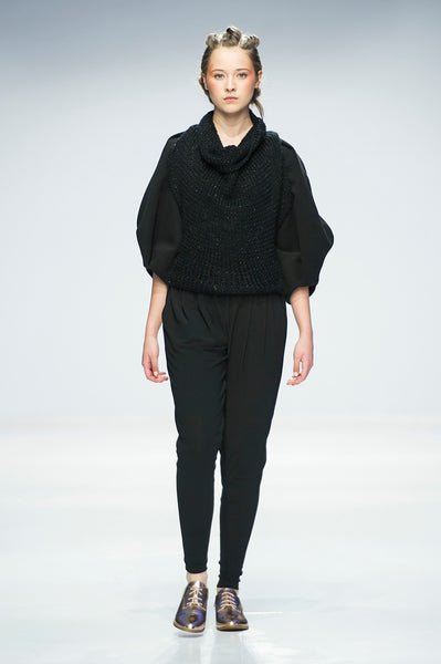 Black knitted top with statement sleeves over trousers