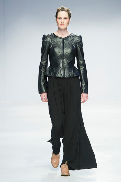 Black leather jacket with topstitched detail over wide leg trousers