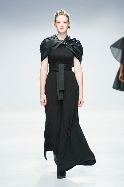 Black full length dress with twisted leather cape