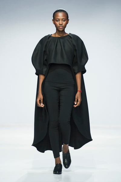 Black hi-lo top with statement sleeves over skinny cut trousers