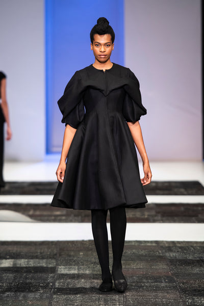 Black wool coat with hart shaped drapped detail over bust and shoulders