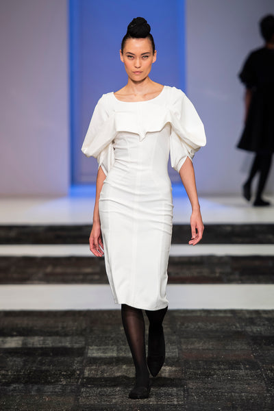 White pencil dress with hart shaped drapped detail over bust and sleeves