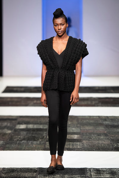 Black textured hand knitted top with skinny cut trousers