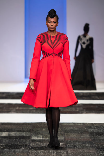 Red wool hour glass coat with black criss cross ribbon detail