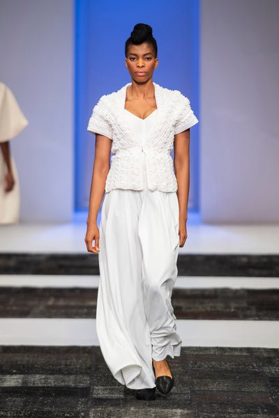 White hand knitted textured top over wide legged pants
