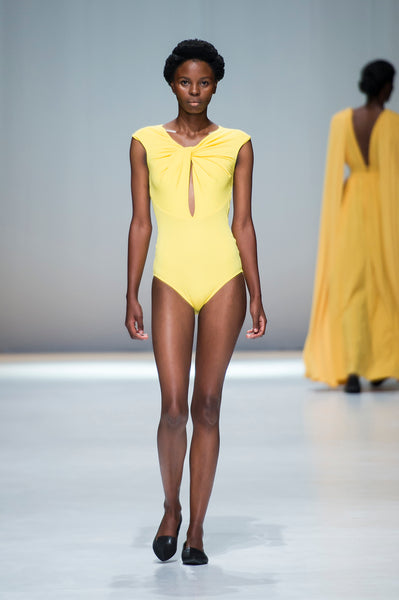 Yellow swimsuit with pleated twist front