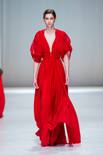 Red full length dress with deep v neck and statements sleeves
