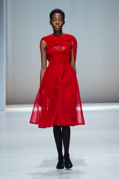 Red knee length mesh fit and flare dress with draped details