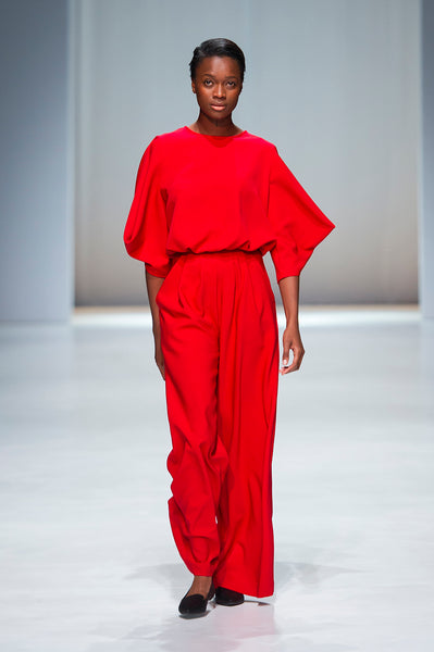 Red jumpsuit with statements sleeves