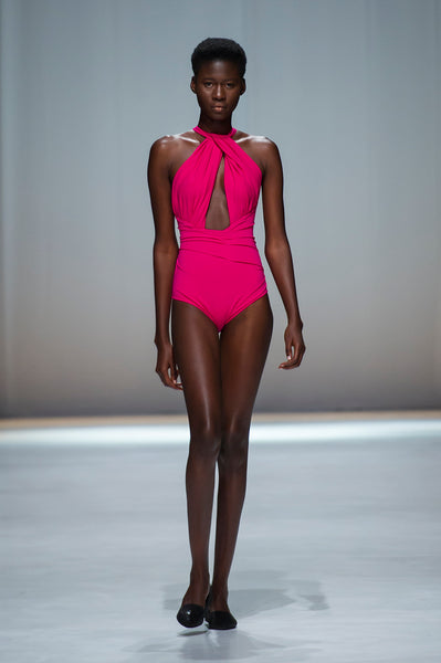 Pink swimsuit with halter neck and key hole detail