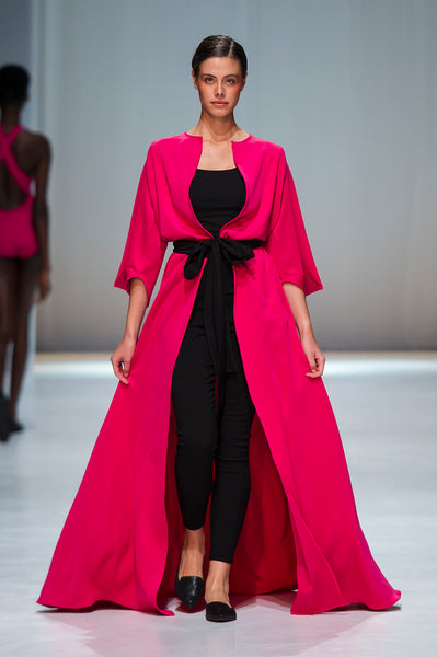 Pink full length cover up over black top and trousers