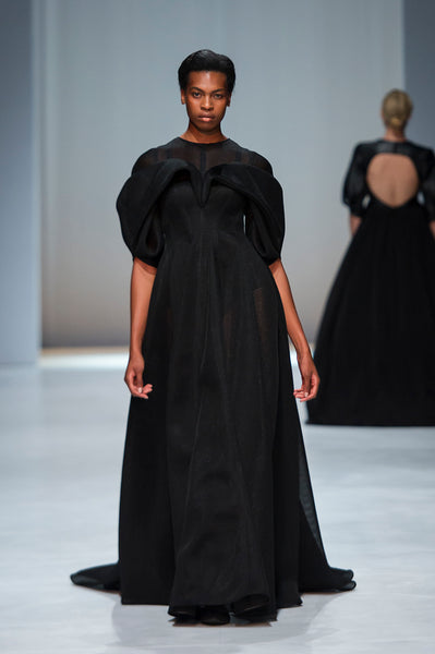 Black full length mesh dress with sculptural draped detail over bust and sleeves