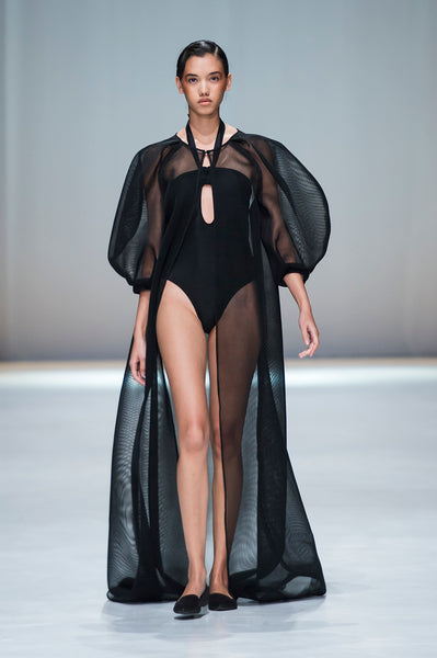Black full length mesh cover up with statement sleeves over halter neck swim suit