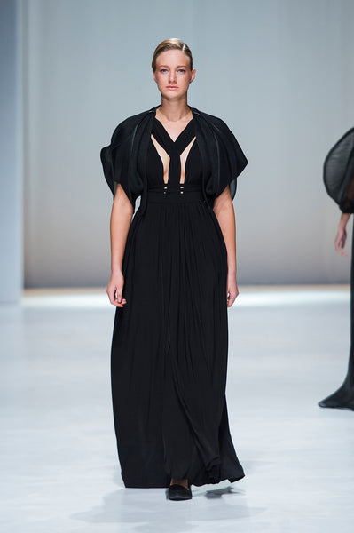 Black full length dress with statement sleeves and deep v-neck with braided detail