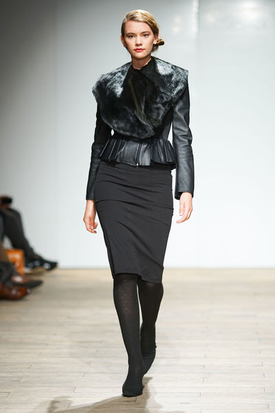 Black peplum leather jacket with springbok fur collar over pencil skirt