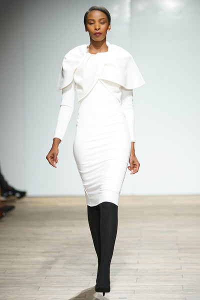 White pencil dress with twisted knot cape detail