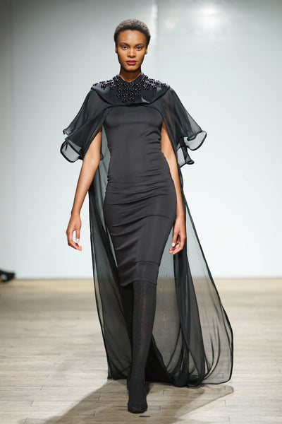 Black knee length pencil dress with layered chiffon cape and button detail bib