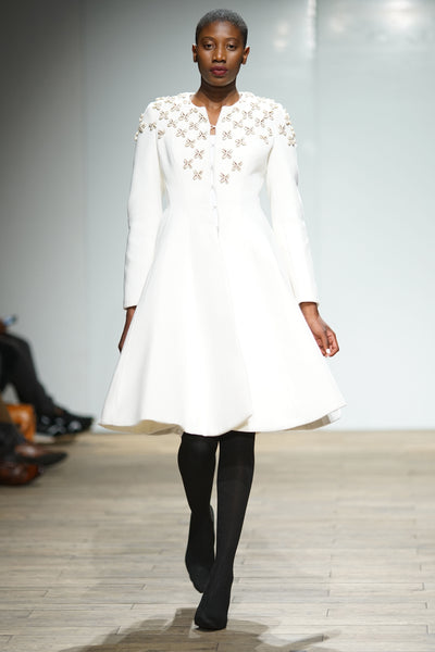 White wool hour glass coat with beaded detail on bodice