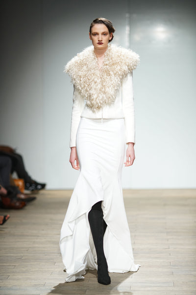 White jacket with mohair shearling collar over hi-lo skirt