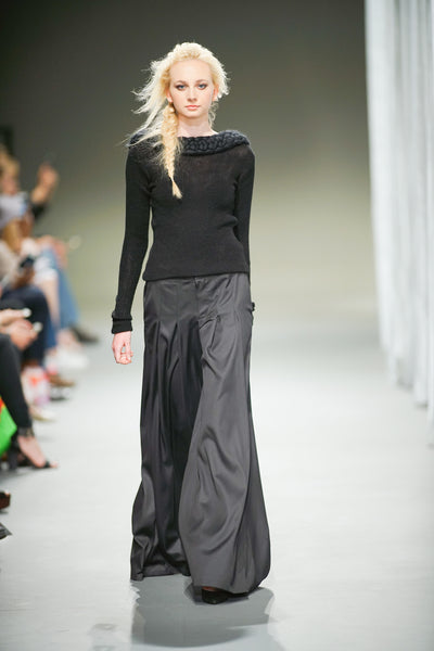 Black wool top with wide leg pleated trousers