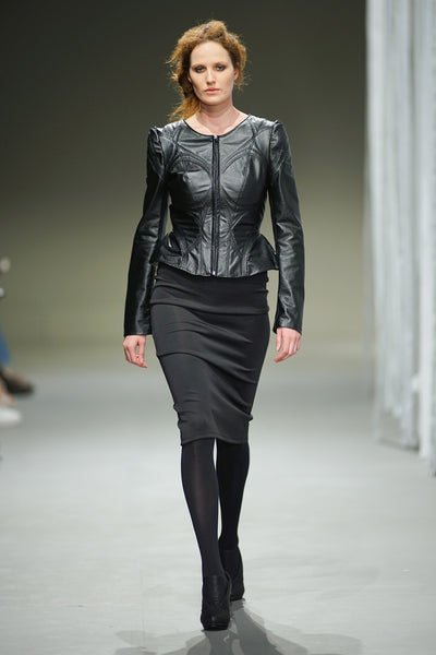 Black leather jacket with top stitching detail over pencil skirt