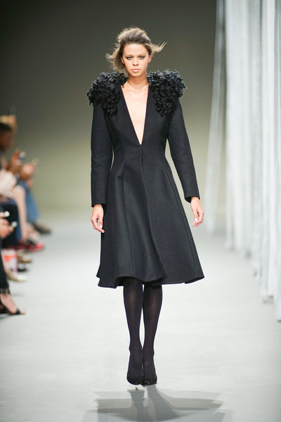Black wool coat with raw wool detail over the shoulders