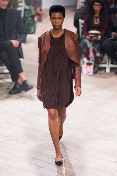 Brown cropped leather jacket with laser cut and button detail over Myri multiway dress