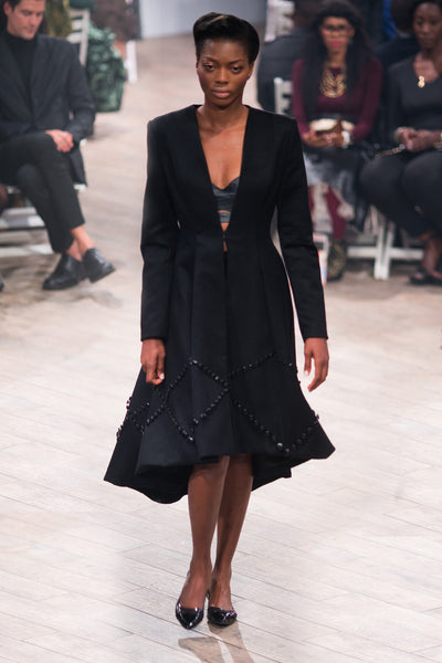 Black wool coat with button detail on hem
