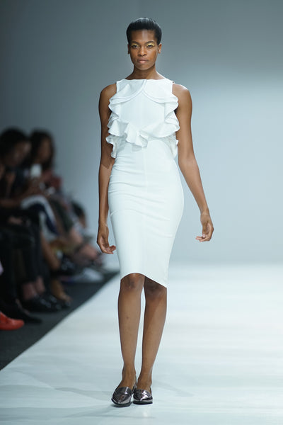 White pencil dress with ruffles on bodice