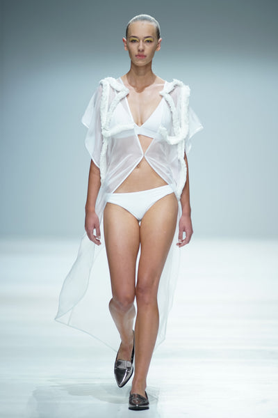 White chiffon cover-up with fringe detail over bikini