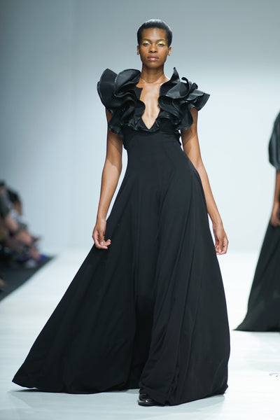 Black full length dress with deep v-neck and sculptural ruffle detail sleeves